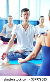 Young man meditating in yoga class