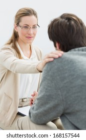 Young man in meeting with a financial adviser at home