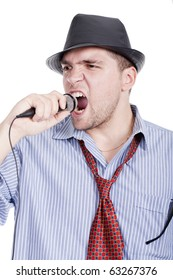 Young man with a microphone and singing