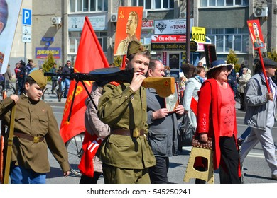 The young man in a military uniform with weapon participates in demonstration in honor of the Victory Day on May 9, 2016. Tyumen, Russia