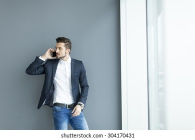 Young man with mobile phone in the office