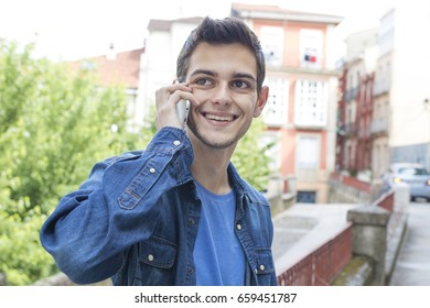 young man with mobile phone outdoors, city