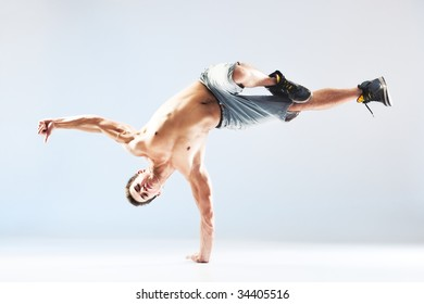 Young man modern dance. On soft white and blue background.