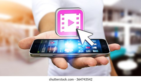 Young man with modern mobile phone in his hand using modern video application