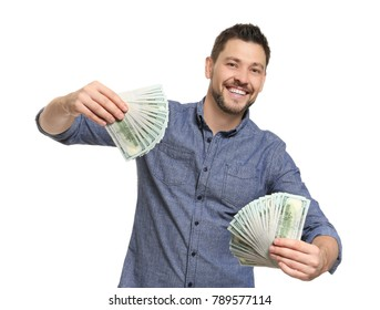 Young man with money on white background
