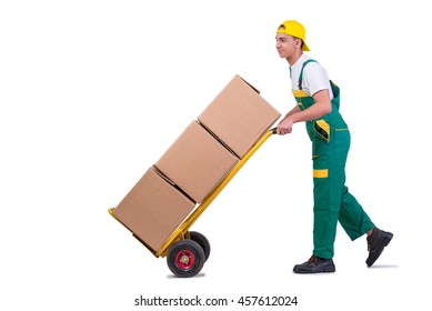 Young man moving boxes with cart isolated on white