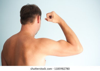 Young man and muscles