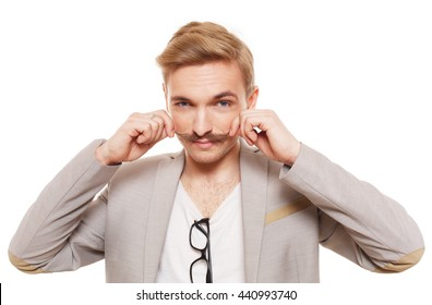 Young man with mustache isolated at white. Handsome guy touch his moustache to show off. Stylish guy with male beauty, seductive person. Nice looking cute hairdresser, metrosexual.