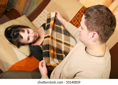 Young man nursing his woman
