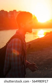 young man on a background of city sunset. close-up