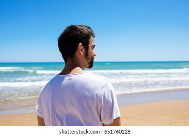 young man on the beach