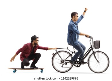 Young man on a bicycle pulling a hipster on a longboard isolated on white background