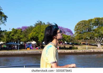 Young man on CityCat on Brisbane River returning from Colorfest where participants throw colourful powder in the air to express freedom and to colour their lives Brisbane Queensland Australia 9 27 201
