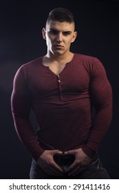 Young man on dark backgrounds with athlete body