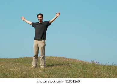 Young man on the grass field with blue sky
