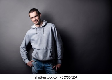 young man on a gray background