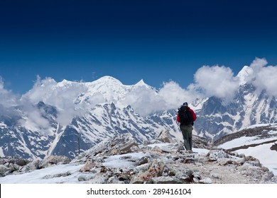 Young man on the hiking path in the mountains of Nepal - Himalayas. Background High mountains