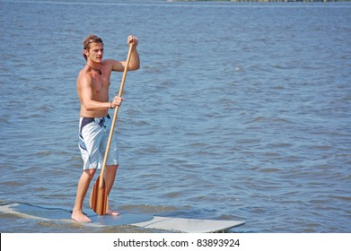 A young man on his paddle-board in the intracoastal river in Florida.
