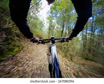 young man on mountain bike. POV, Original Point of View