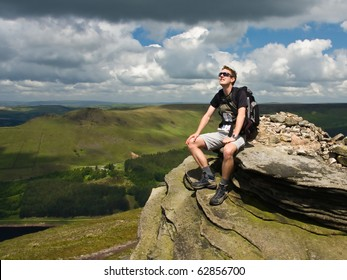 Young man on mountain peak