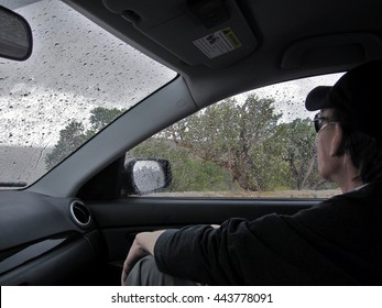 Young Man on Oxygen Sitting in Car During Rain Shower at Grand Canyon Scenic Overlook