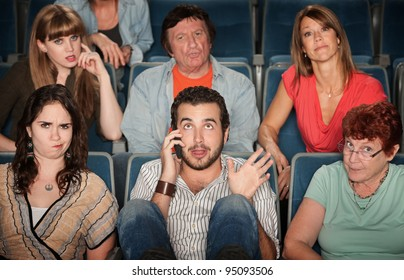 Young man on phone disturbs people in theater