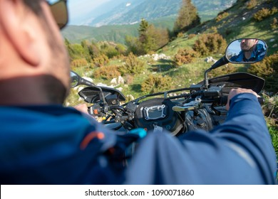 Young man on quad bike on a countryside trail. View from a quad bike.