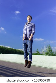 YOung man on a road levitating