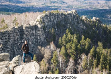 Young man on the rock. Sport and active life concept