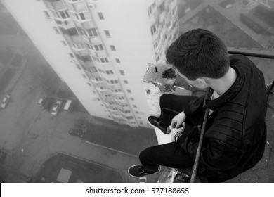 Young man on the roof of suicide black and white