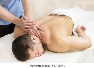 Young man on wellness treatments sports massage