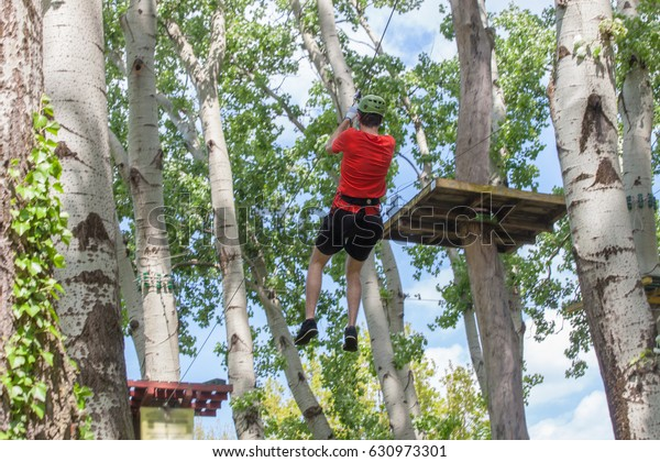Young Man On Zipline Adventure Park Stock Photo (Edit Now