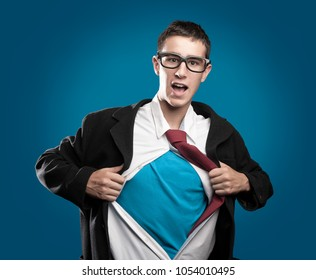 young man opening her shirt like a superhero on a blue background