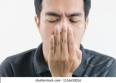 Young man opens his mouth with bad breath concepts
