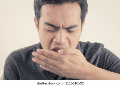 Young man opens his mouth with bad breath concepts with vintage color tone