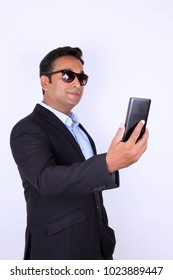 Young man operating smartphone