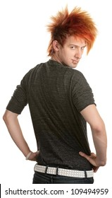 Young man with orange mohawk looking over his shoulder