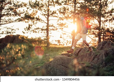 Young man out for a sunset hike