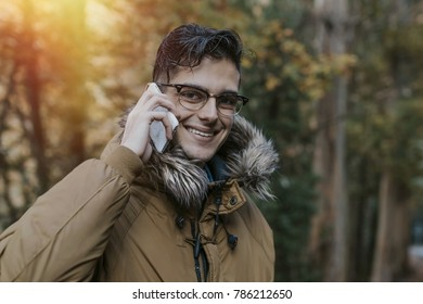 young man with outdoor mobile phone in nature