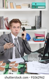 young man overwhelmed with phone calls