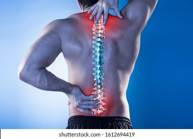 Young Man With Pain In His Back