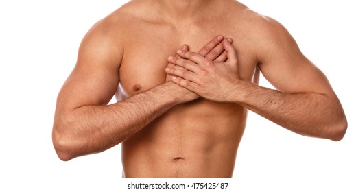 Young man with pain in his chest on white background