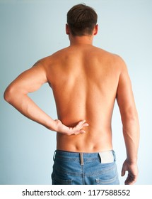 Young man with painful back