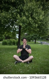 young man in park doing yoga