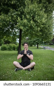 young man in park enjoying in yoga