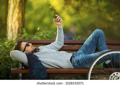 Young man in park texting