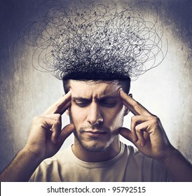Young man with pensive expression and brain melting into lines