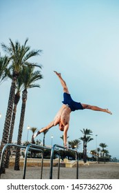 Young man performing a one arm handstand exercise on the street. calisthenics exercise