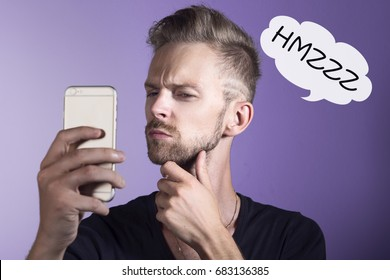 Young man with phone thinking out loud