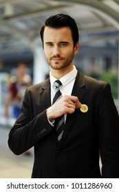 Young man pick bitcoin from suit pocket . Man puts bitcoin in pocket of jacket.Businessman wearing business suit, holding Bitcoin Gold Coin and putting into pocket. Bitcoin concept